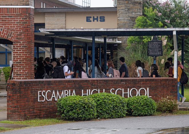 Students gather at the front entrance of Escambia High School, ready to begin a new school year on the first day of school on Monday, Aug. 24, 2020.