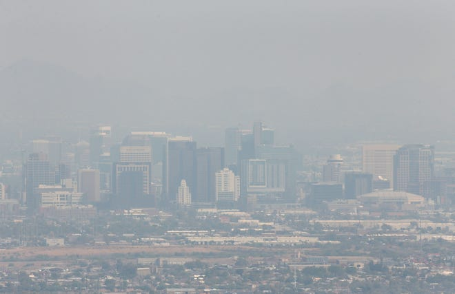 Smoke from fires across Arizona and California are causing poor air quality and hazy skies in Phoenix on Aug. 24, 2020.