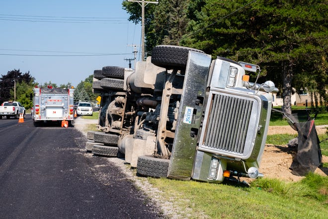 Crews responded to a gravel hauler that overturned on Vincent Road Monday, Aug. 24, 2020, spilling sand into a resident's front yard. There were no injuries, but the road is expected to be closed for several hours.