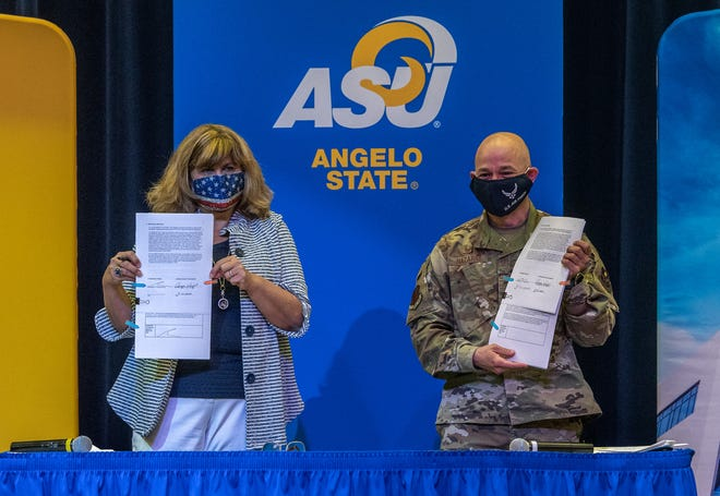 Angie Wright, Angelo State University vice president for finance and administration, and Col. Andres Nazario, Goodfellow Air Force Base 17th Training Wing commander, display the agreements between the two institutions Friday, Aug. 21, 2020, to house GAFB students on ASU's campus, and to facilitate faculty development for GAFB instructors at ASU.