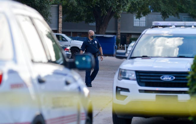 Shreveport police's Lt. Anthony Adams is seen walking in the parking lot of an apartment complex off East Kings Highway between Carroll Street and Southfield Road in Shreveport on Monday, Aug. 24, 2020. Shreveport police responded to the scene after a report of shots fired.