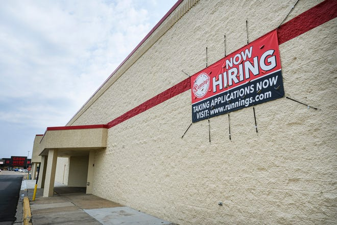 A sign announces employment opportunities at the new Runnings store Monday, Aug. 24, 2020, in St. Cloud. The store is located in the former St. Cloud Shopko East building and plans to open in mid-September.