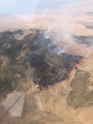 """A wildfire called the """"Baboon Fire"""" burning north of Cedar City is photographed in this image provided by the Utah interagency wildfire group."""