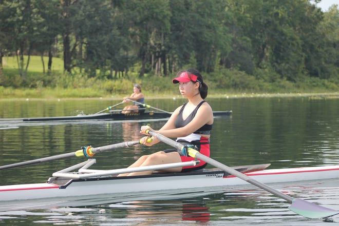 Sarah Herr of Leon (background) and Tracy Qu of Chiles work on their endurance at Lake Hall.