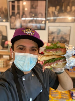 Frank Ficarra, the owner of Leonardo's Deli in New City with his special Labor Day sandwich, the Danny Zuko's Summer Lovin.