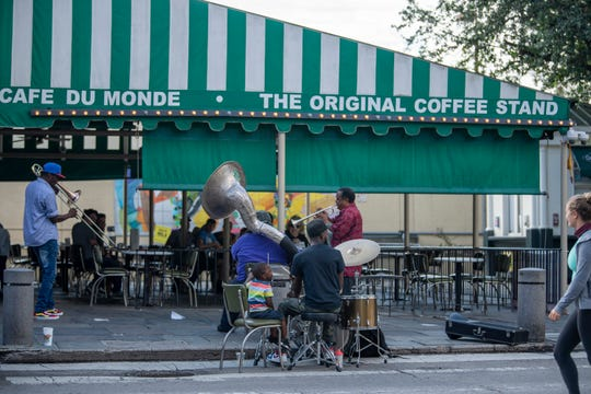 Jazz musicians play outside a nearly empty Cafe Du Monde in the French Quarter on the day Tropical Storm Marco was expected to hit the Gulf Coast.