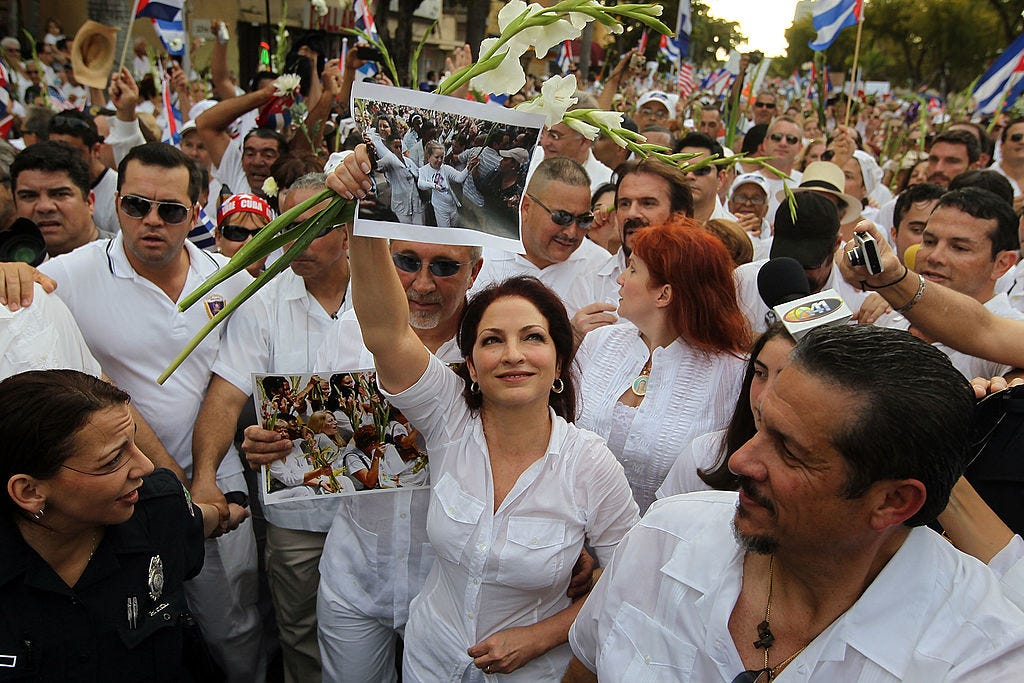 Musicians Gloria and Emilio participate in a 2010 march on behalf of peaceful Cuban dissidents Las Damas de Blanco, or the Ladies in White, in Miami.
