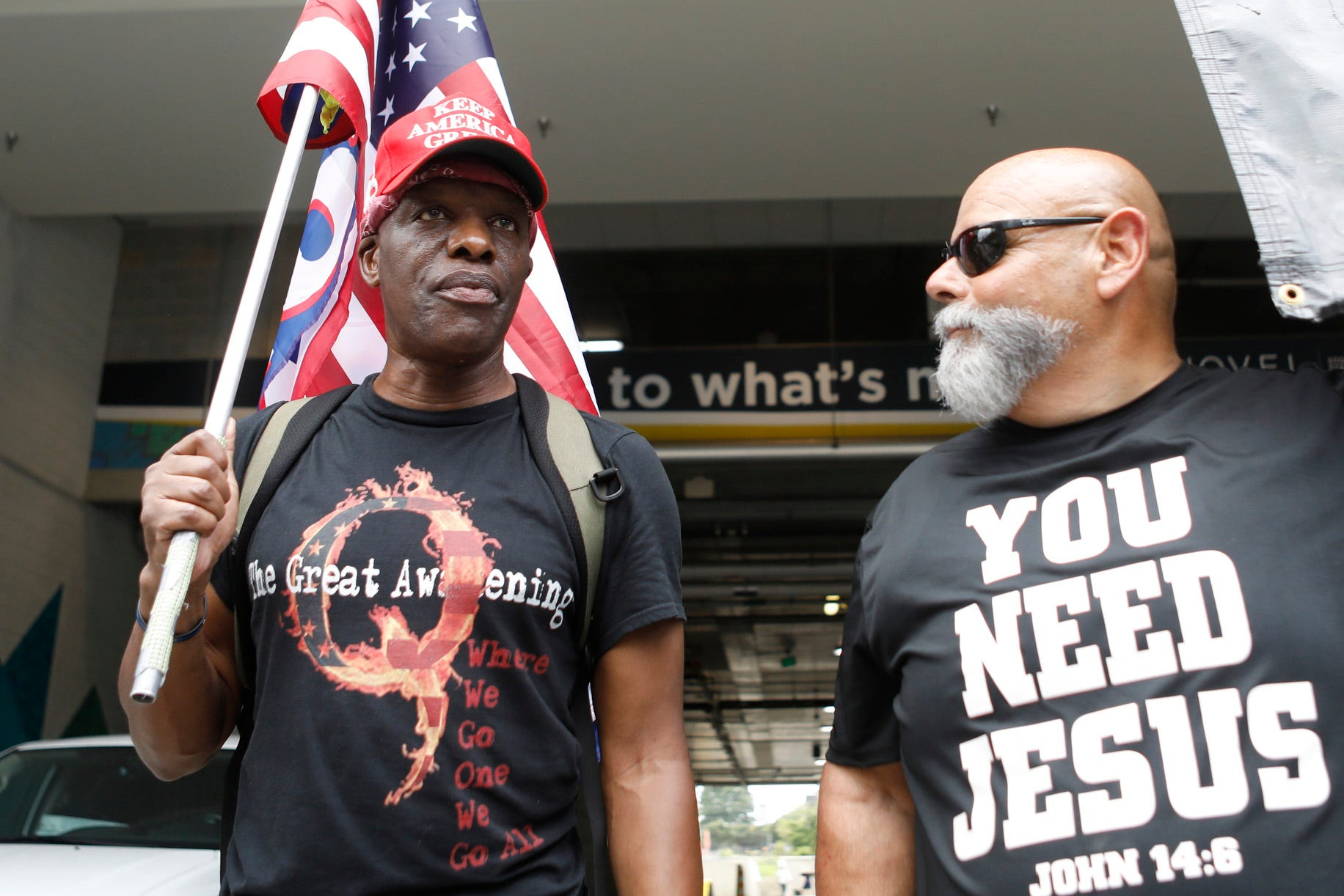 Ken Lane, a supporter of President Donald Trump and QAnon (L), and Ruben Israel of Bible Believers talk about their political beliefs near the Republican National Convention in Uptown on August 24, 2020 in Charlotte, North Carolina.
