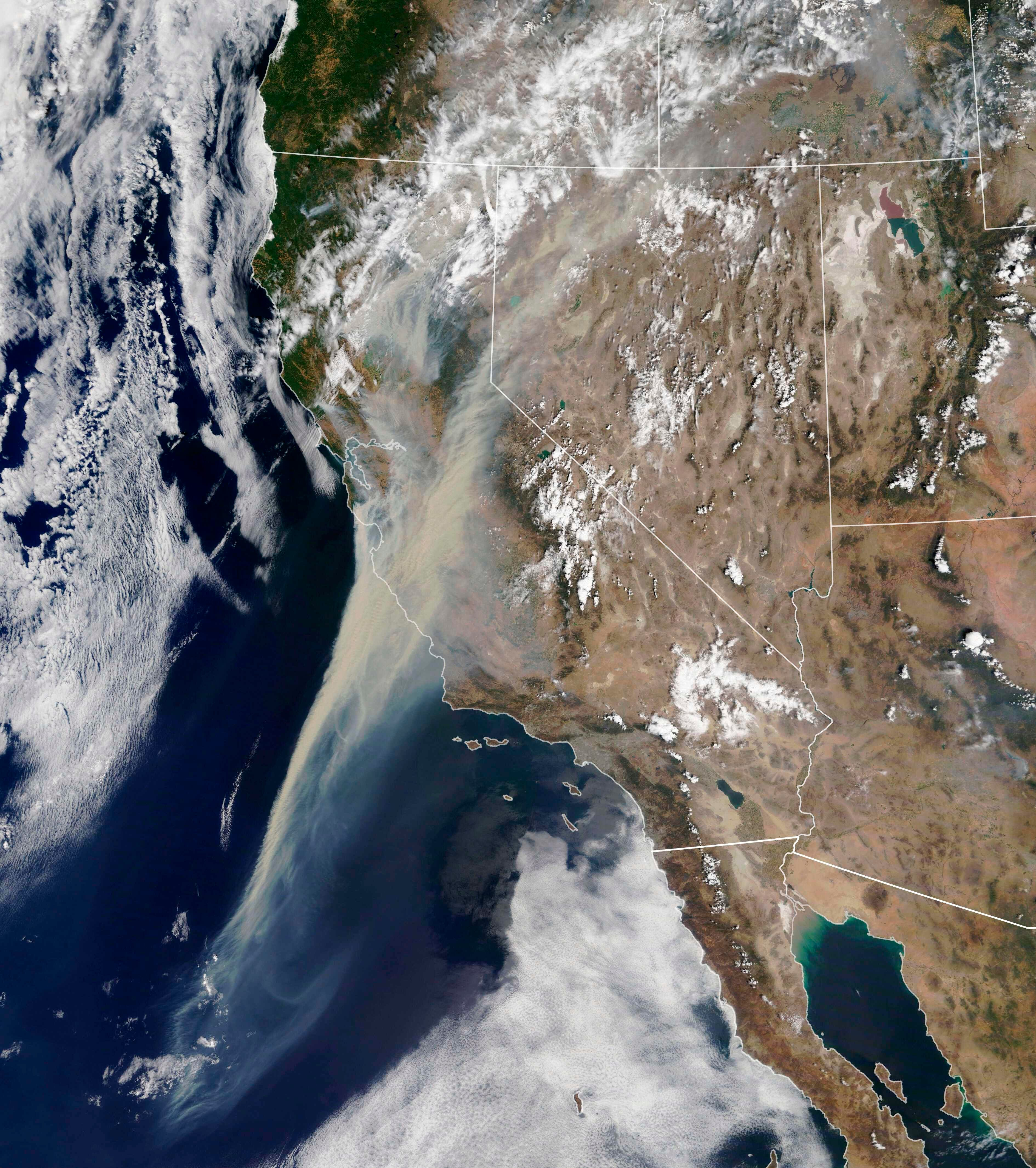 This NASA Earth Observatory photo shows on Aug. 19, 2020, wildfires moving across northern California, with enormous smoke plumes smothering cities and towns in the San Joaquin Valley and San Francisco Bay area.