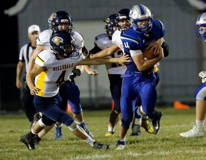 Northwestern's Hal Huber (right) runs past Hillsdale's Ethan Goodwin (left) during high school football action on Sept. 20, 2019 at Northwestern High School.