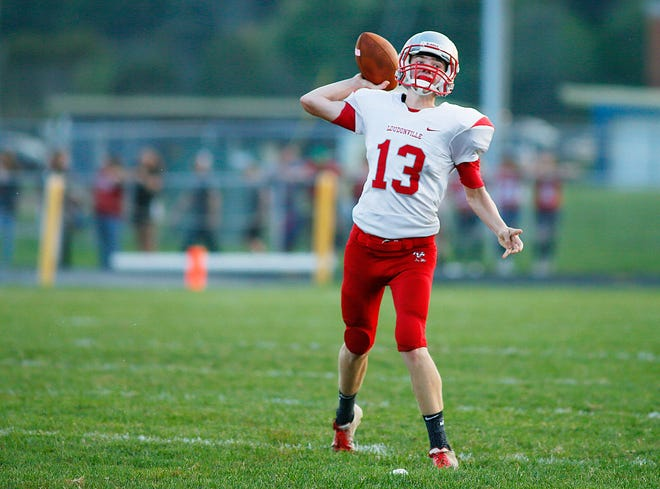 Loudonville quarterback Logan Huffman (13) throws a pass during a high school football game against Hillsdale on Friday, Sept. 13, 2019 at Hillsdale High School.