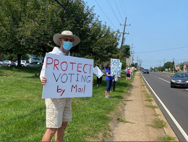 Demonstrators outside the Southampton post office on Street Road on Tuesday protest recent cutbacks for the U.S. Postal Service they believe to be politically motivated. [CONTRIBUTED]