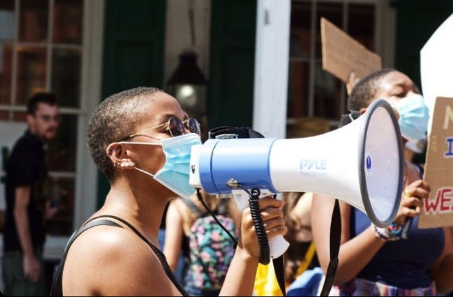 20-year-old Betsy Watson protests at a Black Lives Matter rally in Doylestown on Aug. 2