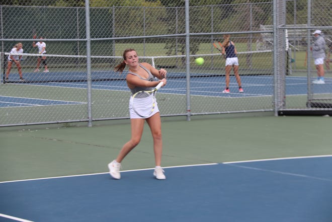 Catherine Tiedemann returns a shot during her match Tuesday afternoon. Tiedemann won at No. 1 singles 6-0, 6-0 as Crookston cruised past Roseau, 6-1.