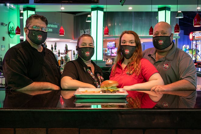 The Via team, led by General Manager Jason Shindoll, far right, are ready to serve at Via Entertainment in Leesburg.