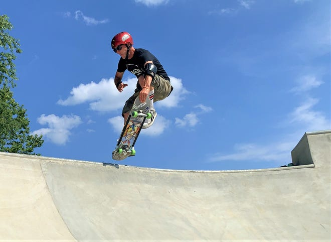 Professional skateboarder Doug Brown of Wooster applies his trade at the new skatepark at Deer Run Park in Millersburg in July. Brown gives the village of Millersburg a lot of credit for doing the park right.