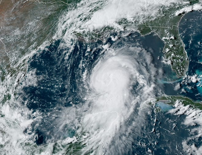 A satellite image shows Hurricane Laura as it churns Tuesday afternoon through the Gulf of Mexico.