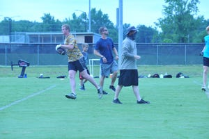 Oak Grove's Jared Gibble runs after catching a pass during a summer workout at the school. Gibble has committed to Virginia Tech and will enroll in January. [Mike Duprez/The Dispatch]