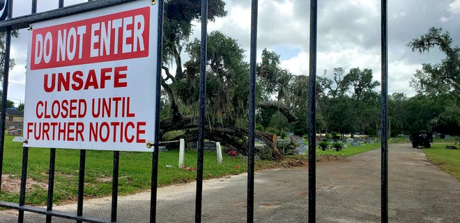 The historic Oakdale Cemetery in DeLand remained closed on Tuesday, Aug. 25, 2020, a week after a tornado came through the area, knocking down live oak trees and several grave markers.