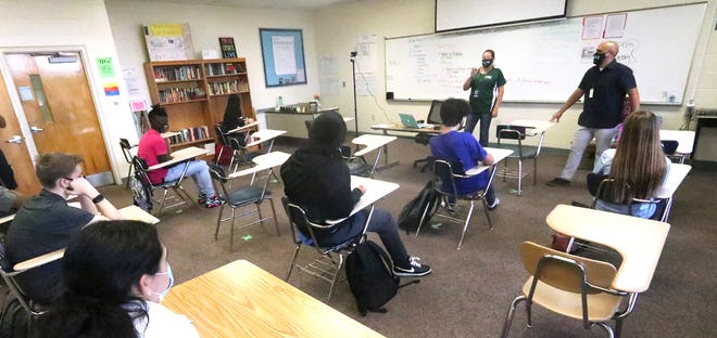 Teachers Dana Silvernail and Javier Bevacqua talk to students in their class at Flagler Palm Coast High School during the coronavirus pandemic. Tuesday August 25, 2020.