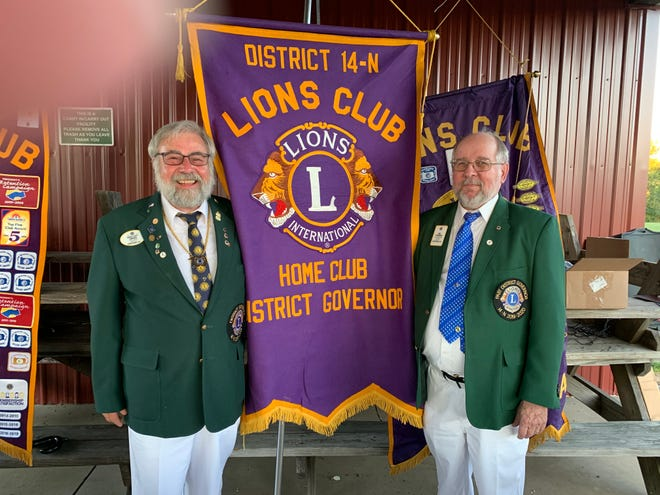 """Lions Club International had a Passing of the Banner ceremony last Thursday at outgoing District Governor Kim Stevenson's home club, the Volant Lions. The banner was passed to incoming District Governor Erwin """"Chip"""" Campbell, of the Riverside Lions. Campbell, left, is the governor of District 14N, one of 17 districts in the state of Pennsylvania comprised of five counties with close to 1,000 members. Stevenson stands at right."""