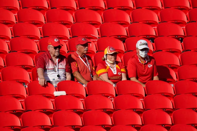 Fans watch the Kansas City Chiefs during an NFL football training camp Saturday at Arrowhead Stadium. The Chiefs opened the stadium to 2,000 season ticket holders to watch practice as the team plans to open the regular season with a reduced capacity of approximately 22 percent or normal.