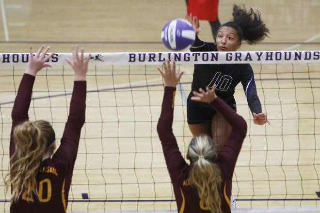 Burlington High School's Madison Bunton (10) puts the ball over the net during their match against Mount Pleasant High School, Monday Aug. 24, 2020 at Burlington's Johannsen Gymnasium.