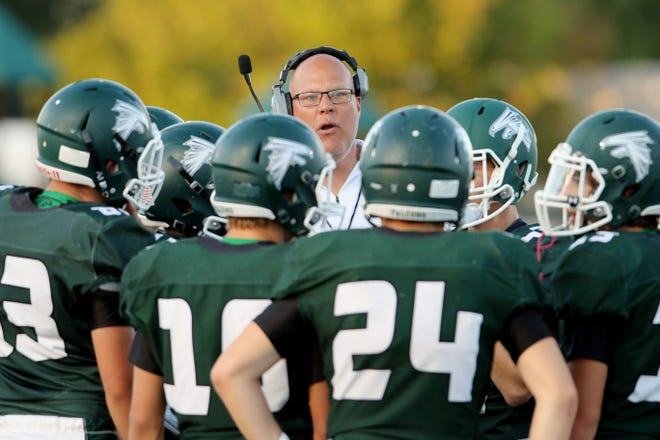 West Burlington-Notre Dame High School's head coach Jay Eilers talks with payers during their game against Fort Madison High School last season at West Burlington's Bill Nelson Field.