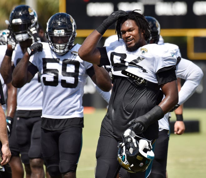 Jaguars defensive linemen Carroll Phillips (59) and Dawuane Smoot (94) move to their next station during training camp practice Tuesday, August 7, 2018 at the TIAA Bank practice fields in Jacksonville, Florida.  [Will Dickey/Florida Times-Union]