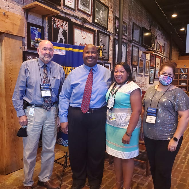 Pictured are School Superintendent Tim Cooley, Harry Hooker, Shamika Hooker, and Ashley Craddock.
