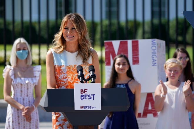 First Lady Melania Trump visits an exhibit of artwork by young Americans on Monday in celebration of the 100th anniversary of the 19th amendment, which afforded the vote to women, at the White House in Washington.