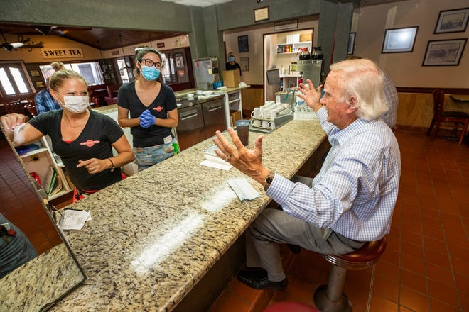 Bill Wise, right, chats with waitresses Stacey White, left,  and Yang Li during a lunchtime visit at Reececliff  Family Diner in Lakeland on Tuesday. The longtime family restaurant reopened Aug. 18 after having been closed for 5 months.