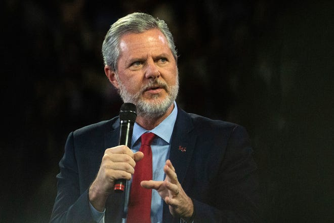 "Liberty University President Jerry Falwell Jr. talks to Donald Trump Jr. about his new book ""Triggered"" during a November 2019 convocation at Liberty University in Lynchburg, Va. Falwell said Tuesday that he has resigned as head of evangelical Liberty University because of ongoing controversies about his wife's sexual involvement with a younger business partner and in the wake of a social media photo that caused an uproar."