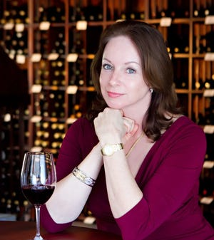 Master sommelier Virginia Philip will resume wine tastings in her Royal Poinciana Plaza shop with seating limited to 14 people. DAILY NEWS FILE PHOTO