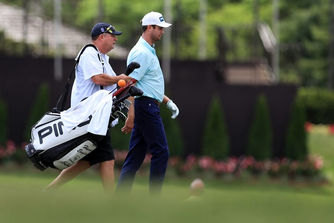 Harris English and caddie Eric Larson walk from the 10th tee during the final round of The Memorial Tournament at Muirfield Village Golf Club last month. [AARON DOSTER/USA Today Sports]