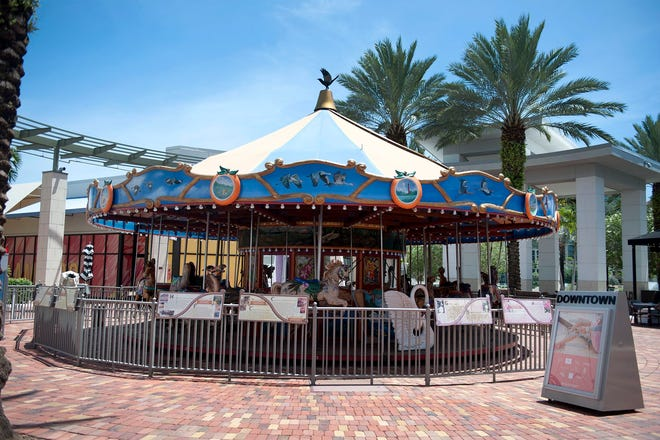 The children's carousel at Downtown Palm Beach Gardens will be taken apart Wednesday for refurbishment. It will move to the lakefront in 2021. [MEGHAN MCCARTHY/palmbeachdailynews.com]