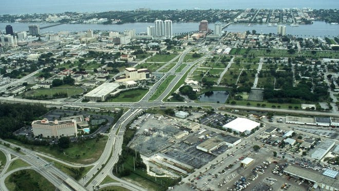 East and southeast of the Kravis Center, this July 1994 aerial shows the Downtown/Uptown project area grassed over and unused. It wasn't developed for years.