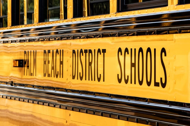 Palm Beach County school bus in West Palm Beach, Friday, March 13, 2020. [ALLEN EYESTONE/palmbeachpost.com]