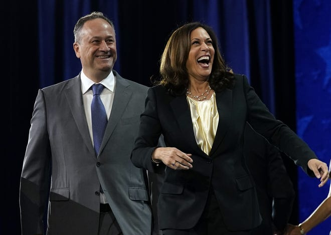Democratic vice presidential candidate Kamala Harris and husband Doug Emhoff during the fourth day of the Democratic National Convention in August.