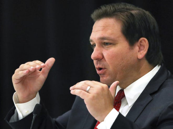 Florida Gov. Ron DeSantis answers a question during a roundtable meeting with transportation industry leaders at the Hilton Orlando-Bonnet Creek Resort in Orlando, on Aug. 7. (Joe Burbank/Orlando Sentinel via AP)