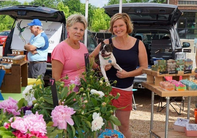 From left to right, Brenda Morris, her granddog Charlie, and her daughter Rachel Chieppa enjoy the River Street Market in Old Towne Petersburg.