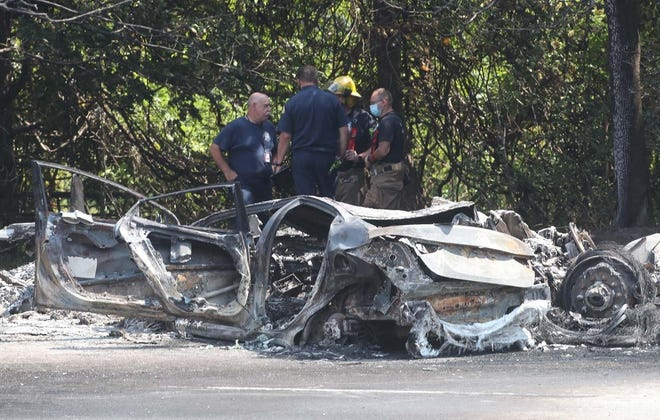 The charred remains of a car after it was involved in an accident with a tanker truck on state Route 8 northbound between Tallmadge Avenue and Howe Avenue Tuesday, Aug. 25, 2020 in Akron, Ohio.  [Karen Schiely/Beacon Journal]