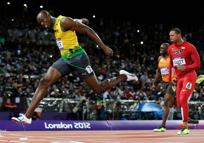 FILE - In this Aug. 5, 2012, file photo, Jamaica's Usain Bolt crosses the finish line to win gold in the men's 100-meter final in the Olympic Stadium at the 2012 Summer Olympics in London. [AP Photo/David J. Phillip, File]