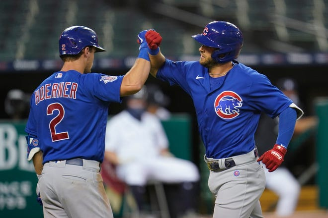 Chicago Cubs' David Bote celebrates his solo home run with Nico Hoerner (2) in the fourth inning of a baseball game against the Detroit Tigers in Detroit on Monday. [AP Photo/Paul Sancya]