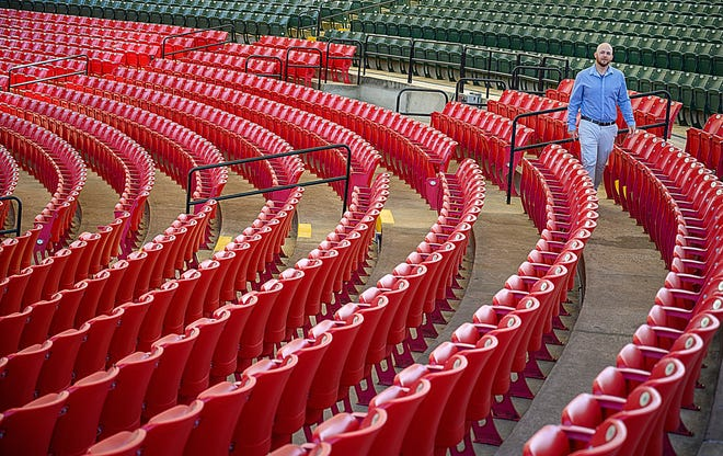 St. Augustine Amphitheatre General Manager Gabe Pellicer walks through the seats of the facility in St. Augustine on Friday. [PETER WILLOTT/THE RECORD]