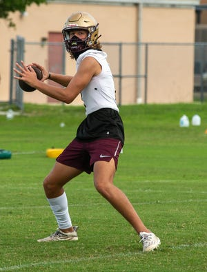 St. Augustine quarterback Sammy Edwards fires during an Aug. 24 practice at St. Augustine High School. Edwards, a senior, will enter his third year as the Yellow Jackets quarterback.