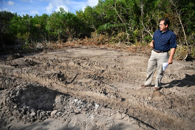 Longboat Key Utilities Director Isaac Brownman in July during a tour of the site where a sewage pipe leaked an estimated 26 million gallons of sewage into Sarasota Bay.