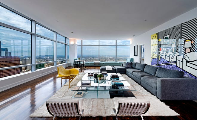 """Jason Blum, who produced the films """"The Purge"""" and """"Get Out,"""" is asking $6.995 million for his corner penthouse at the Ritz-Carlton Residences at L.A. Live. The 4,250-square-foot unit features a wealth of open-concept space, multiple dining areas and a private terrace. Walls of floor-to-ceiling windows take in sweeping views of the downtown skyline and the L.A. Live pavilion below. (William MacCollum)"""