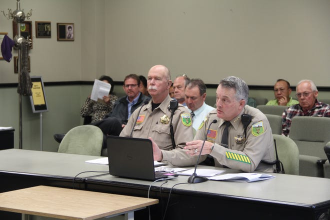 Siskiyou County Sheriff Jon Lopey, right, sits next to Undersheriff Karl Houtman during a Board of Supervisors meeting in 2016.