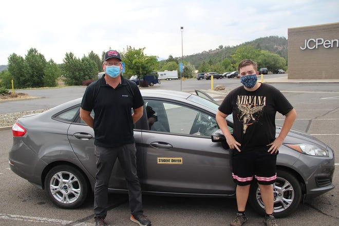 Driving instructor Scott Forrester and student Conner Wilson, 16 of Weed, get ready to go out for Conner's first driving training at the parking lot in front of JcPenny's in Yreka last week.
